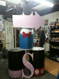 Mickey and friends trash cans. My husband painted these himself for our baby girl's bday party.
