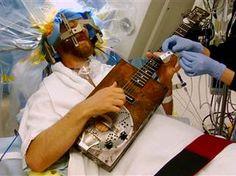 Man has brain surgery while awake, playing guitar