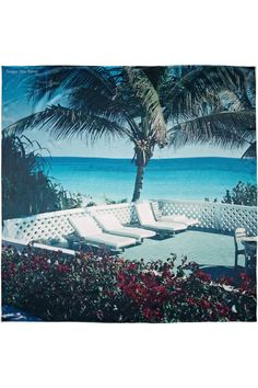 Escape to the beach no matter the weather with Temps des Rêves' silk-satin scarf. This light-as-a-feather piece is printed with a vivid photograph of Harbour Island taken by the label's founder, Adrian Mesko.