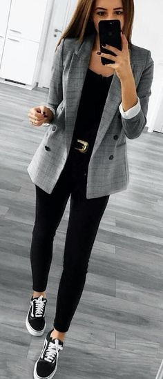 #spring #outfits woman in gray blazer, black shirt, and black leggings standing holding smartphone. Pic by @questionlook