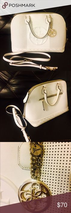 CLASSY WHITE GUESS HANDBAG  Gently used very classy white Guess handbag, bought from Macy's couple months ago. Don't use it anymore. No defects. Guess Bags Satchels