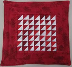 """Red miniature quilt - about 8"""" square."""