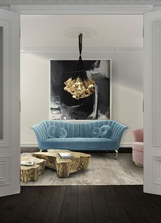 Living Room Ideas | CAPRICHOSA Sofa, GIA Chandelier from Koket and EDEN Center Table by Boca do Lobo See more: https://www.brabbu.com/en/all-products.php