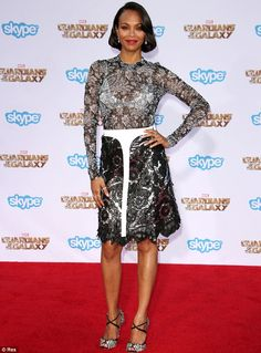 Out of this world! Zoe Saldana arrived at the Guardians Of The Galaxy premiere in a bra-bearing black and silver metallic dress http://dailym.ai/1yXVFOf