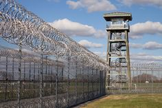 Prison Fence Watch Tower And Barbed Photograph Abandoned Prisons, Abandoned Places, Wall Exterior, Fortification, U.s. States, Door Signs, Outdoor Structures, Building, Fences
