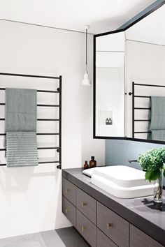 bathroom design - grey floor tiles, white walls & dark wood vanity