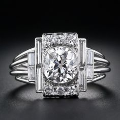 A fabulous, one-of-a-kind, original high-Art Deco diamond ring, hand crafted in platinum, circa 1925, showcasing a dazzling 1.60 carat antique cushion-cut diamond.