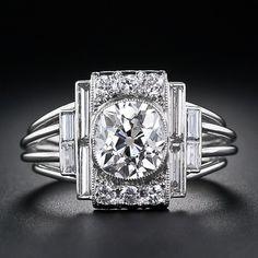 A fabulous, one-of-a-kind, original high-Art Deco diamond ring, hand crafted in platinum, circa 1925, showcasing a dazzling 1.60 carat antique cushion-cut diamond.