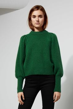 The Duet Sweater combines fine feminine details in a subtle design. Knitted in a wool blend with just a bit of mohair for and extra soft touch, it has a ri