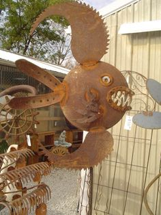 upcycled metal fish scultpture from rusty saw blades