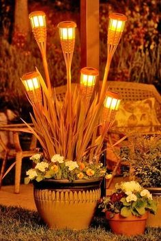 Tiki Torches w/solar lights in planter to light up your Luau. Diy Garden, Garden Planters, Lawn And Garden, Garden Art, Cement Planters, Garden Gazebo, Garden Paths, Big Planters, Potted Garden