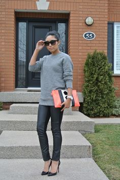 Mens wear inspiration  hnm mens sweater, hnm leather pants, hnm clutch, Christian Louboutin Heels, Michael Kors watch, Dolce and gabbana sunglasses