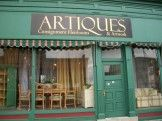 Artiques Heirlooms & Art  ____________________________  Proud to offer a much-needed outlet for buyers and sellers of high quality, gently used home furnishings. Just a few of the items that we routinely have available are: scatter and room size rugs, vintage and modern jewelry, sterling silver pieces, antique and vintage art, china, glassware and a large selection of furniture. In our back room you will find a selection of vintage clothing. We carry the works of several local artists.