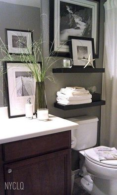 Bathroom Decor Inspiration! shelves over toilet, black and white prints maybe splash of color