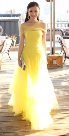 Ray of light pre-Met Gala: Chinese actress Ni Ni in a lemon-citrine yellow Ralph Lauren evening dress as she prepared for last night's Met Ball during her whirlwind tour of NYC