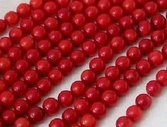 """CORAL: CO160n 10 strands 8x8mm Red Coral round beads 15"""", as low as $40.18."""