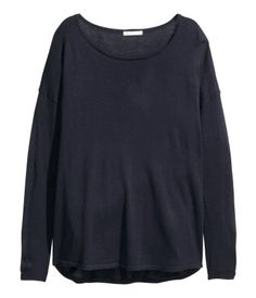 Dark blue. Soft, fine-knit sweater in a loose fit. Wide neckline, dropped shoulders, and long sleeves. Slightly longer at back.