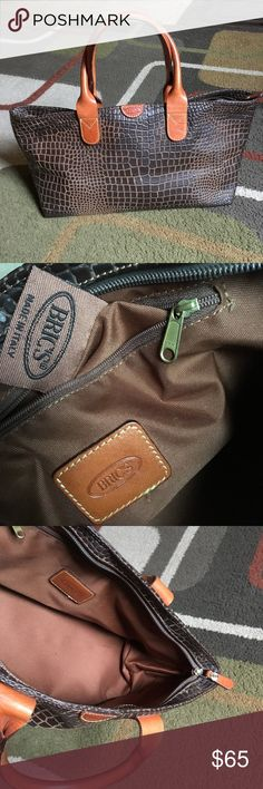 """Bric's bag💞 Italian made Bric's bag💞 crocodile embossed pvc with leather trim💞 inside 1 zip pocket💞gold tone hardware 💞no stains no tears 💞bag measures approx W 15"""" X H 7.5"""" X D 6"""" 💞 Bric's Bags"""