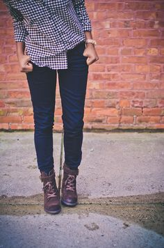 navy and white checkered button-up shirt with dark was denim jeans and brown ankle boots