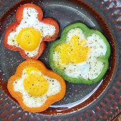 Slice peppers into rings. Heat your frying pan and add oil or butter. Place sliced rings in pan and fry for a few minutes then turn them over. Crack an egg into each ring. If the whites start to escape around the bottom of the ring, simply press ring with spatula to form a seal at the bottom. Once the whites have set, carefully turn rings over and cook for a few minutes more.  Serve with toast and coffee!