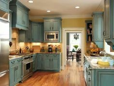 I've always wanted turquoise cabinets!