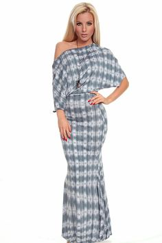934c2c1b2e6 This fun maxi dress features an off the shoulder neckline