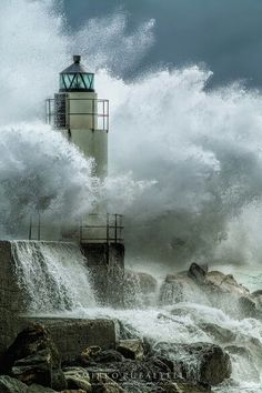 Just from the photo, you can feel the power this wave has as it crashes onto the rock foundation and lighthouse. Much power, much strength!