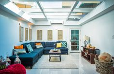 Cool Underground Room with Patio Above. During renovations, the owners dug into the yard to create an underground family room with porcelain tile floors and a glass ceiling.