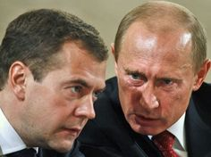 """Prime Minister Vladimir Putin is very obviously angry at his President Dmitry Medvedev. Alpha dog, Putin: red-faced; distended veins (left temple) consistent with increase in blood pressure; head tilted down; eyebrows together and lowered; mid-face tightening (sides of nose); nostril dilation; jaw jut. Body language ""cluster"" of anger."""