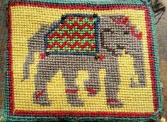 Elephant pincushion in needlepoint.