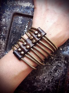 Molly Conant made one just for me. Love it! Rounded Brass Ribcage Bracelet brown leather by rackkandruin, $85.00
