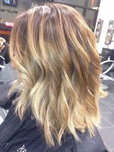 11 Bombshell Blonde Highlights For Dark Hair   Gorgeous Hairstyle Ideas by Makeup Tutorials at http://makeuptutorials.com/11-bombshell-blonde-highlights-dark-hair/