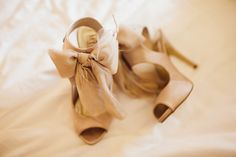 """From the bride ~ """"My shoes were from DSW. I wanted something dramatic but since I wasn't using much color in the wedding, I went for a huge bow instead."""" On http://StyleMePretty.com/texas-weddings/2012/04/10/dallas-wedding-at-the-room-on-main-by-sara-rocky/ Photography by saraandrocky.com"""