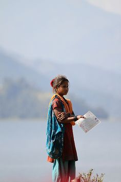 This is a photo of a beggar in Pokhara. They carry these papers of permission to let you know they are legally begging.