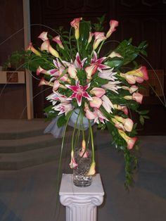 Fantasy Flowers & More ~ Church Alter arrangement. www.fantasyflowersandmore.com
