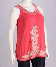 Free-spirited and feminine, this charming coral top is perfect for warm weather days. Intricate floral embroidery blooms along the center of a soft, flowing silhouette.Measurements (size 1X): 32'' long from high point of shoulder to hem95% viscose / 5% spandexMachine wash; hang dryImported
