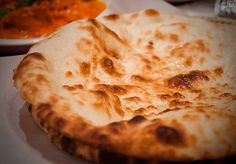 Garlic Butter Naan. Naan is an essential part to any Indian meal.  Traditionally, this flat bread in baked in clay tandoor ovens - Foodista.com