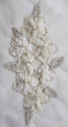 Hand-made motif with applique silk organza flowers