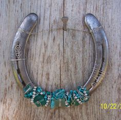 """uniquely beaded horseshoes make charming and rustic western decorations. 