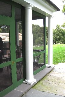 COLUMNS OUTSIDE SCREENED-IN PORCH // KELLY GREEN AND WHITE EQUESTRIAN COLOR SCHEME