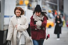 Lessons In Layering From The Streets Of New York City #refinery29  http://www.refinery29.com/2016/02/103173/ny-fashion-week-fall-winter-2016-street-style-pictures#slide-134  Friends who brave the cold together, stay together....