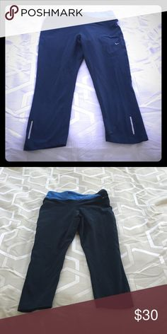 Nike dry fit navy crop leggings These are stretch leggings that fall just below the knees (they don't flare out at the ends, it's a straight fit and won't be loose). Great to wear at the gym! The waist is elastic with a tie and there is a small pocket on the back. Nike Pants Track Pants & Joggers