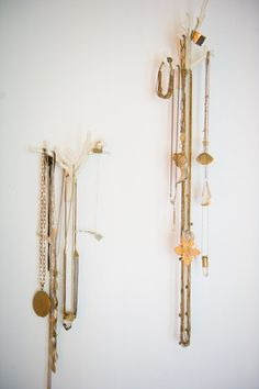 Ashley Camper Photography White branch wall hooks from Urban Outfitters hold Vande Velden's favorite necklaces. Her jewelry collection includes pieces from Sparrow & Sea, Spell and the Gypsy Collective, Vega Jewelry, Alkemie Jewelry and Wings Hawaii.