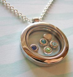 Grandma gift? ---family birthstones locket necklace- fill with your choice of birthstones. $35.00, juliethefish via Etsy.
