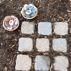 outdoor tic tac toe! Could o this indoors too with cheap tiles from Home Depot and stones you can decorate yourself from the $ store. Each kid could make their own set.