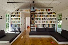 L-shaped couches and tons of books!  Two of my favorite things.  And the bookshelves provide a wall for the loft.