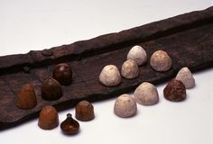 These are playing pieces made form bone, antler and ivory. They are shown alongside a fragment of a board for the game hnefatafl.  From the BBC's website; they don't indicate the find location of these items or where they now are housed.