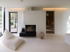 black and white room, fireplace, cove lighting