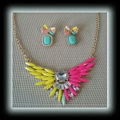 ELEGANT SPRING COLORFUL RESIN RHINESTONE SET An elegant colorful resin choker wing necklace with rhinestones and a sweet pair of resin crystal bow earrings. Jewelry Necklaces