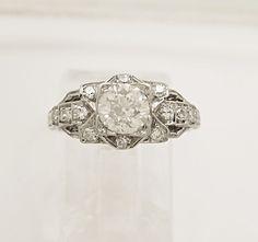 http://www.gesner.com/antique-vintage-jewelry/engagement-rings/antique-platinum-diamond-art-deco-engagement-ring-83.html#